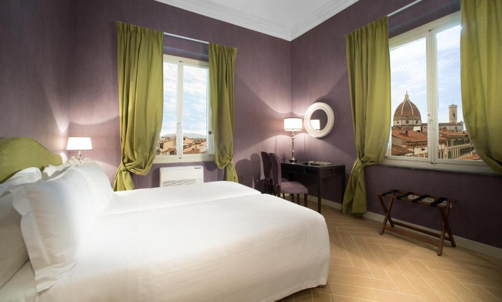 Letto o letti in una camera di San Giuliano Inn