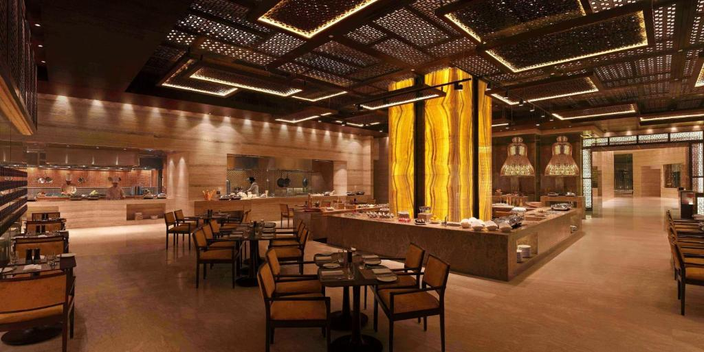 A restaurant or other place to eat at Hilton Jaipur