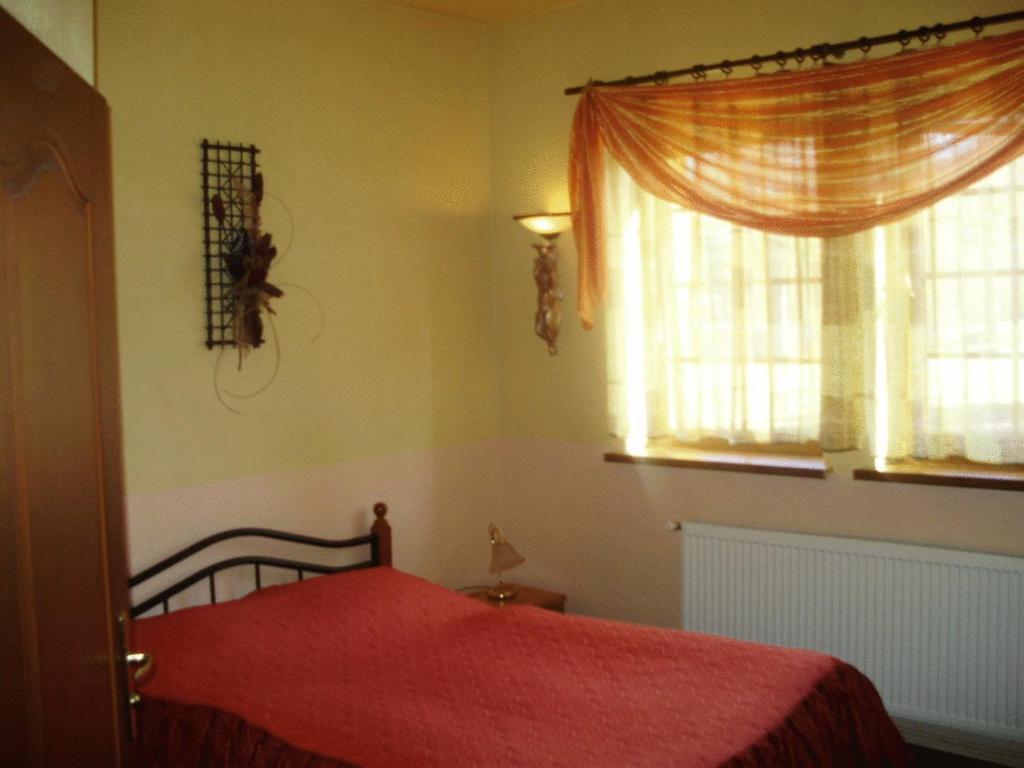 Ein Bett oder Betten in einem Zimmer der Unterkunft Penzion Vysehrad