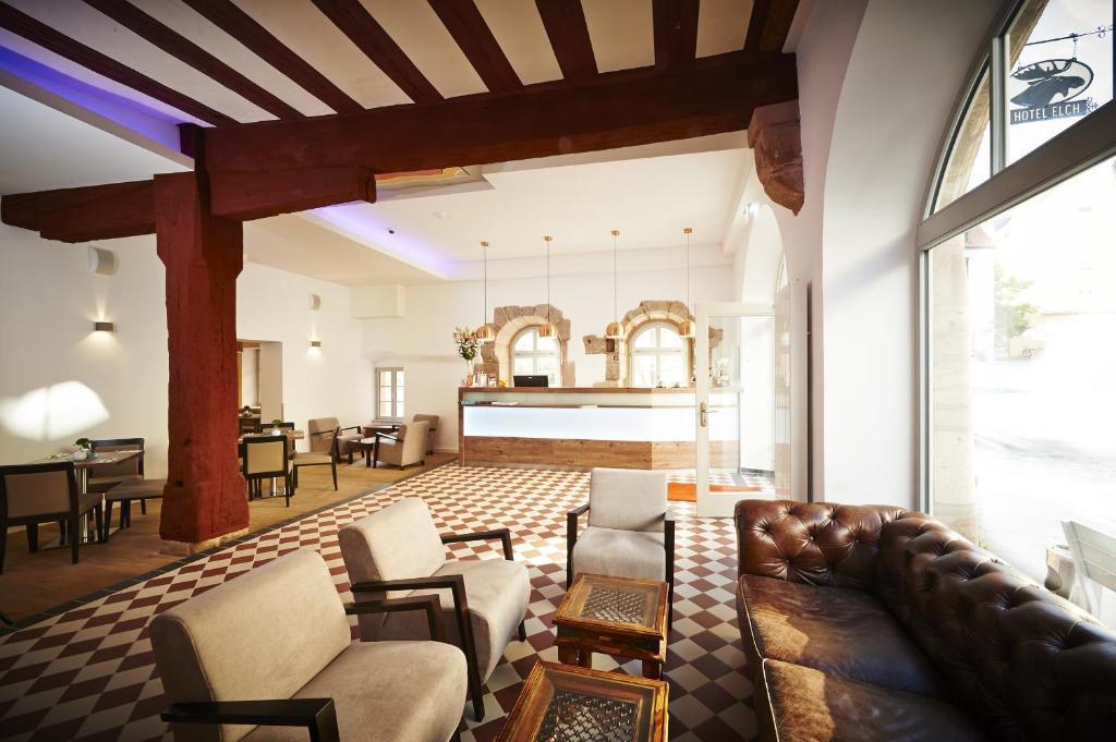 Ein Sitzbereich in der Unterkunft Hotel Elch Boutique