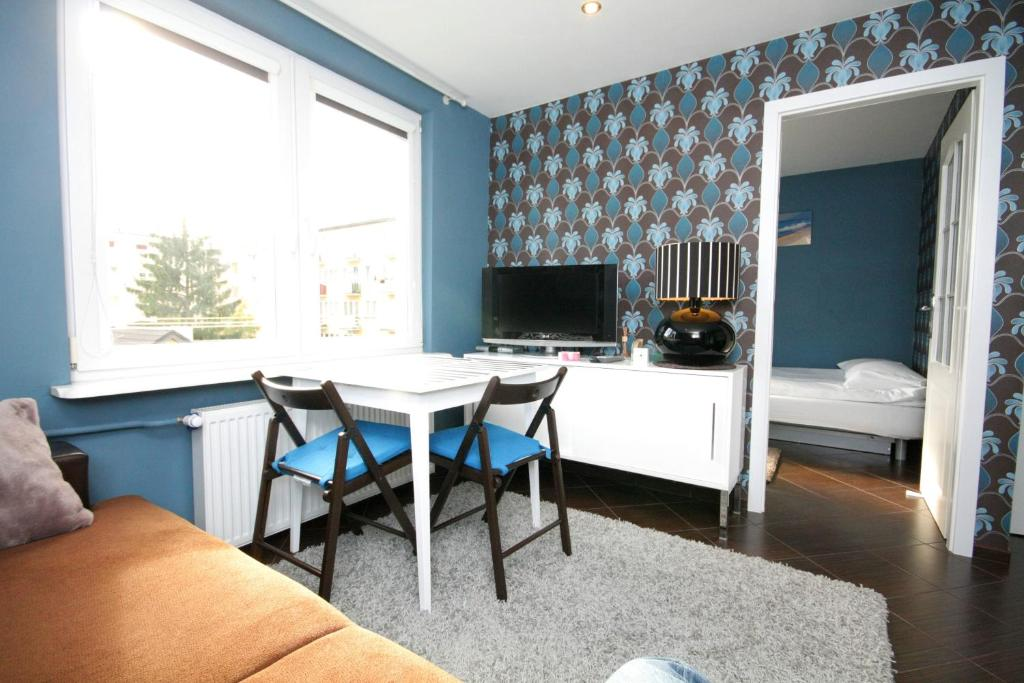 A television and/or entertainment center at Rent a Flat apartments - Mazurska St.
