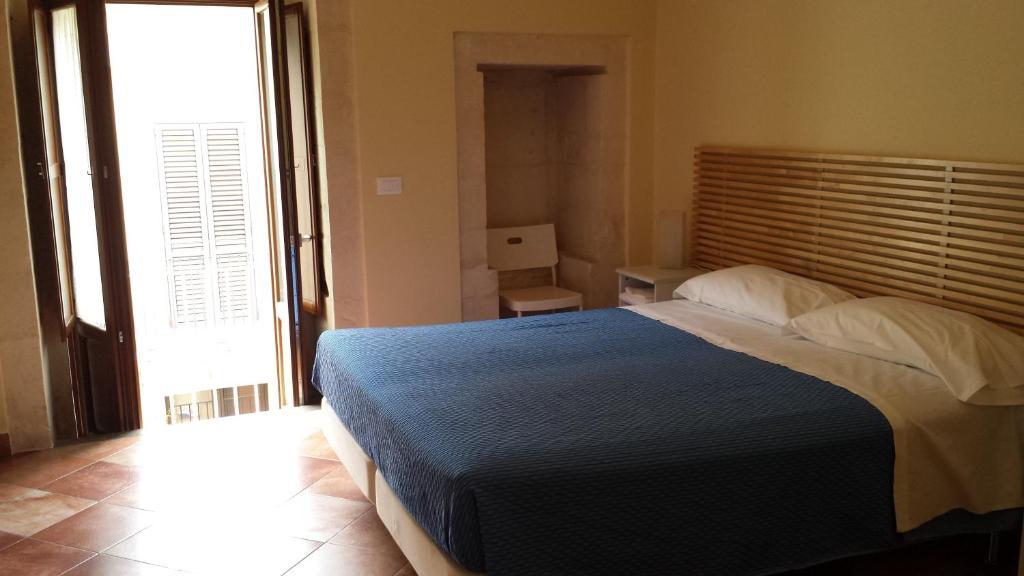 Letto o letti in una camera di Iblea Paradise
