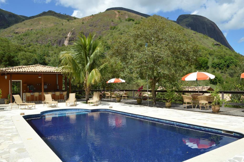 The swimming pool at or near Artesanal Gourmet e Pousada