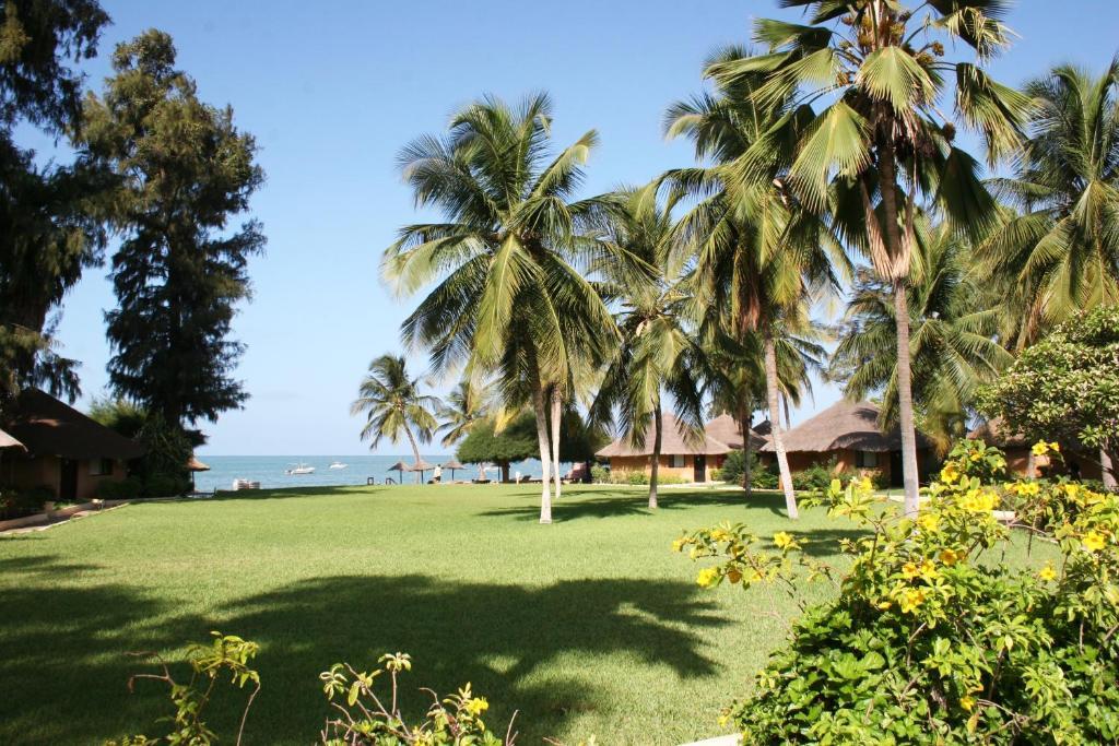 Een tuin van Le Saly Hotel & Hotel Club Filaos