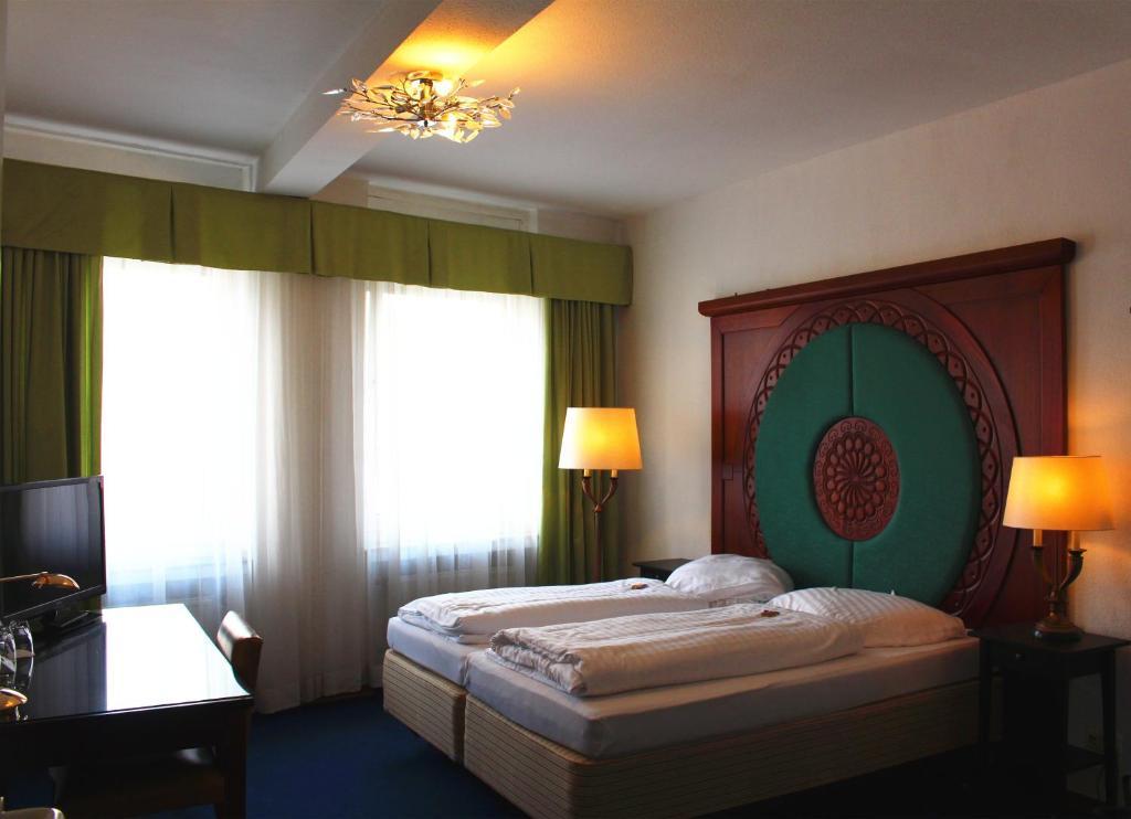 Ein Bett oder Betten in einem Zimmer der Unterkunft Hotel-Restaurant Heute