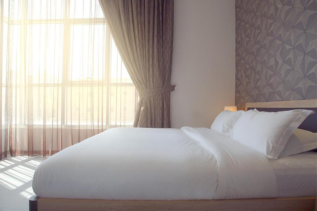 Cama ou camas em um quarto em Rafa Homes - Al Falah