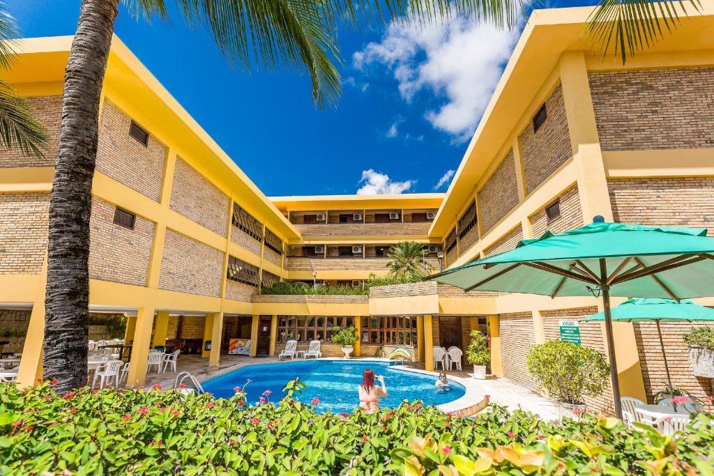 The swimming pool at or near Pizzato Praia Hotel