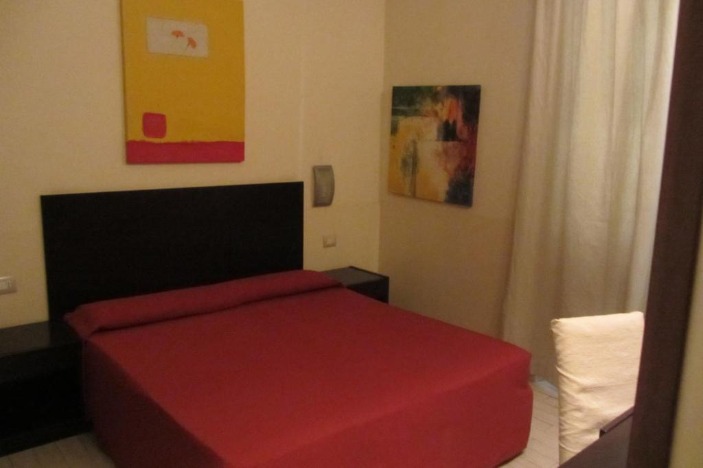 A bed or beds in a room at San Marco Relais