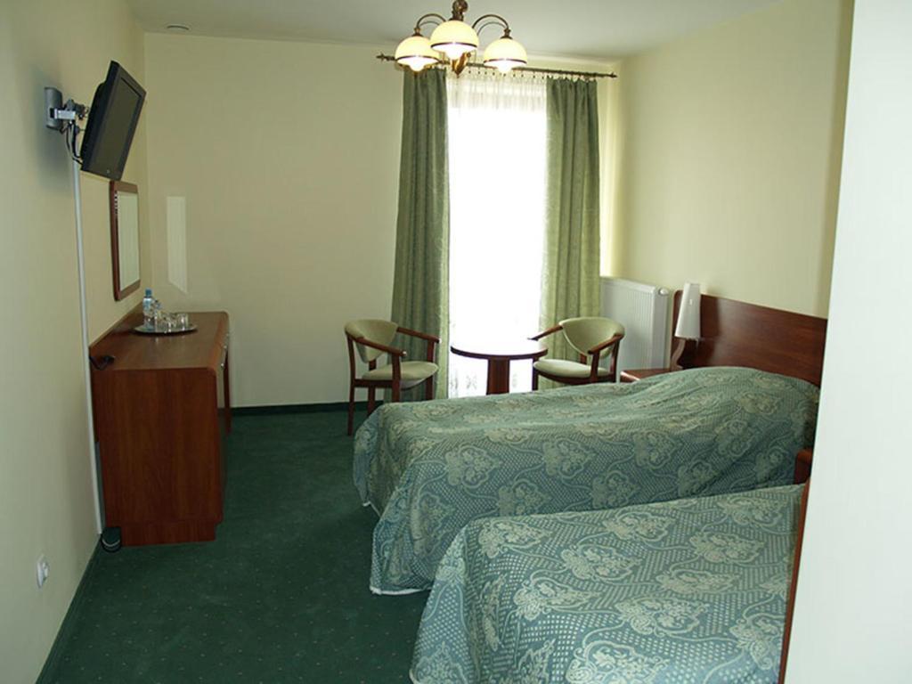Łóżko lub łóżka w pokoju w obiekcie Rancho Tenisowe