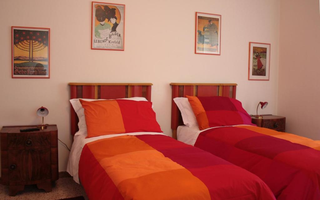 A bed or beds in a room at Affittacamere Parco dei Canapè