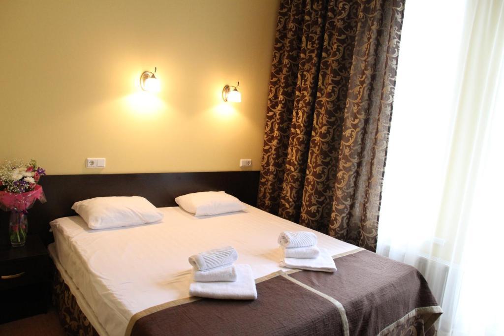 Кровать или кровати в номере Демидов
