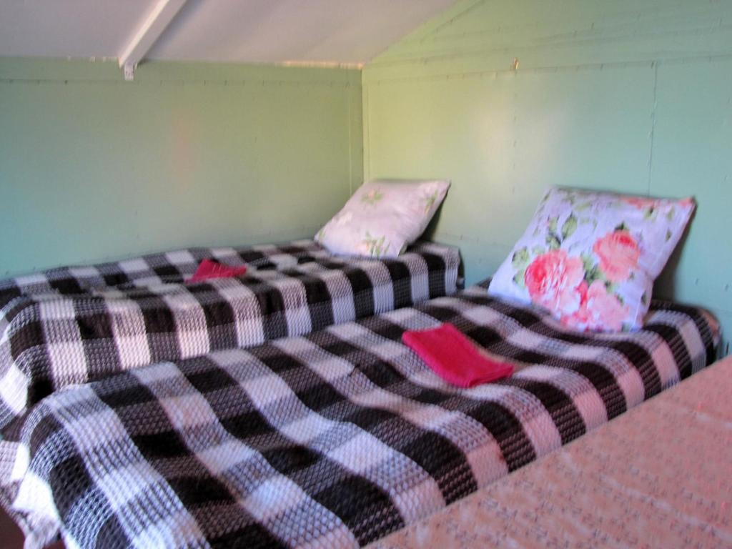 Кровать или кровати в номере База Отдыха Первая Экспедиция
