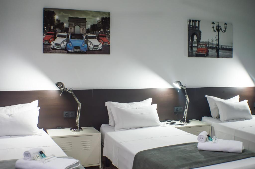 A bed or beds in a room at Quart Youth Hostel & Apartments