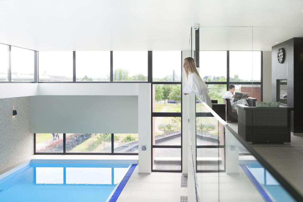 A view of the pool at Hotel Van der Valk Maastricht or nearby