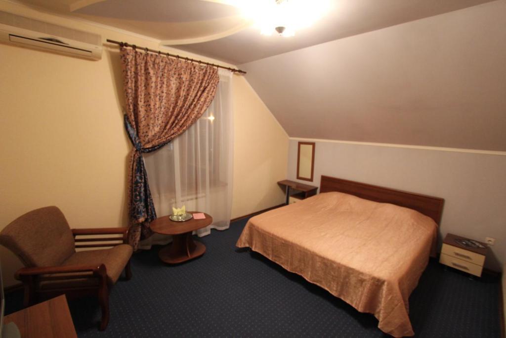 Кровать или кровати в номере Отель Тис