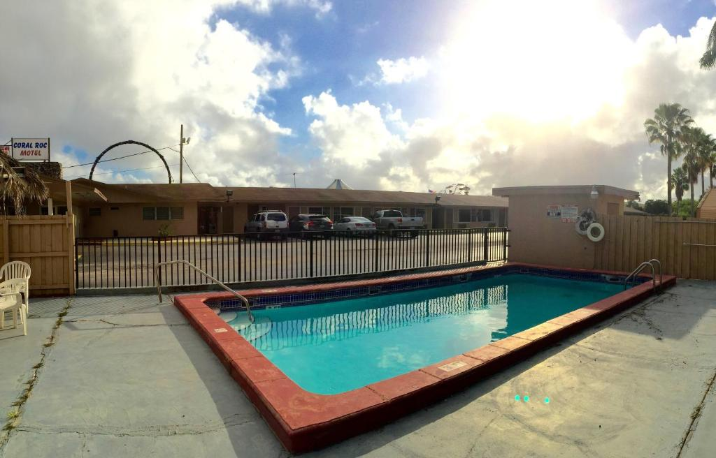 The swimming pool at or near Coral Roc Motel