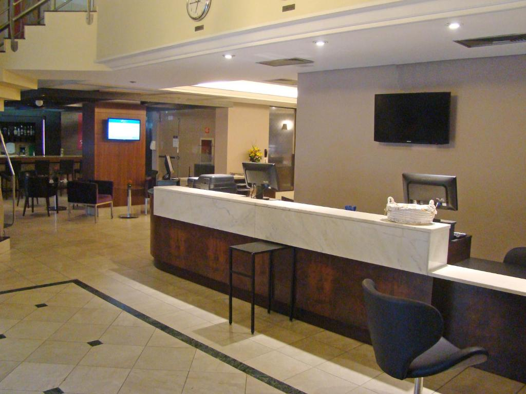 The lobby or reception area at Blue Tree Towers Saint Michel