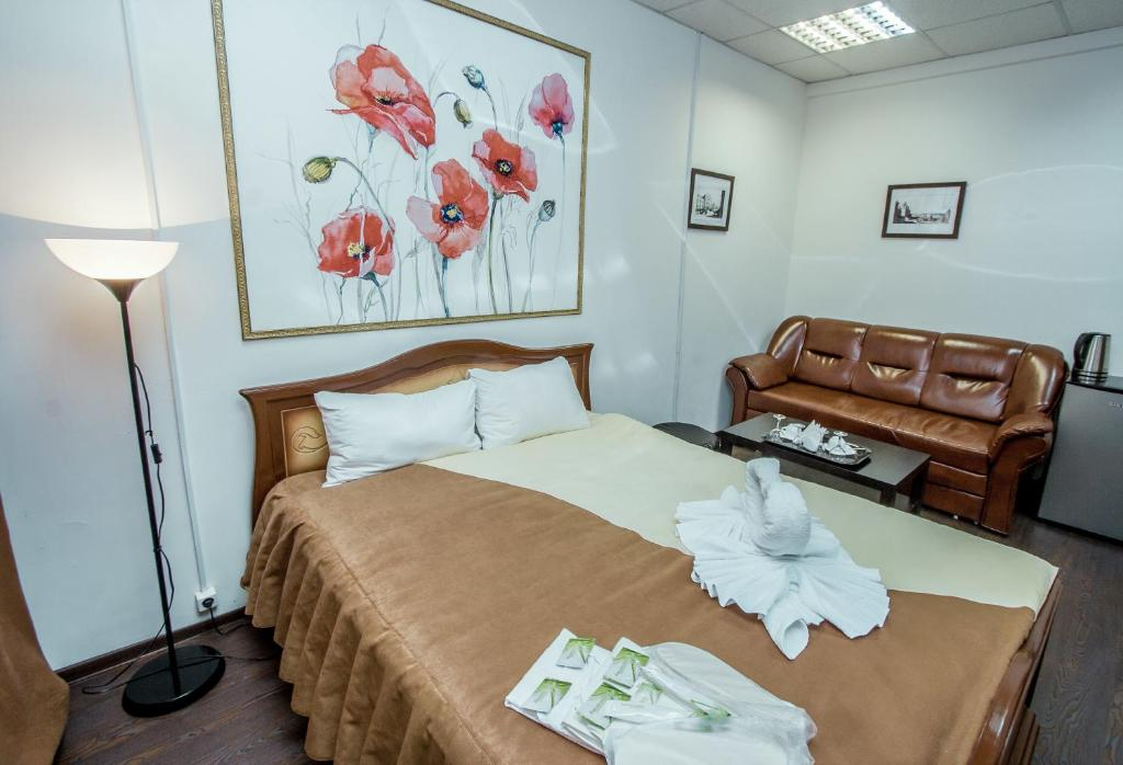 A bed or beds in a room at Welcome Minihotel