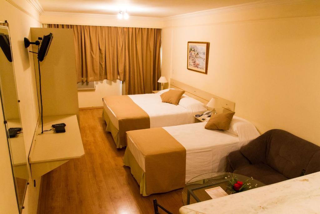 Cama ou camas em um quarto em Harbor Self Buriti Hotel