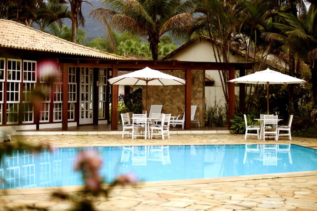 The swimming pool at or near Villas De Paraty