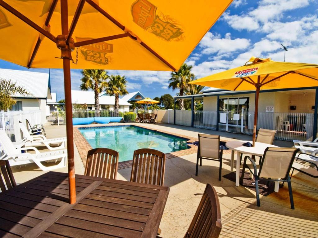 The swimming pool at or near Torquay Tropicana Motel
