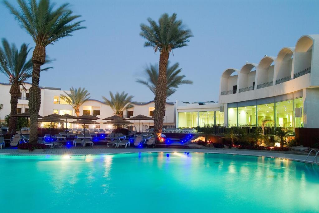 The swimming pool at or near Leonardo Privilege Eilat Hotel - All inclusive