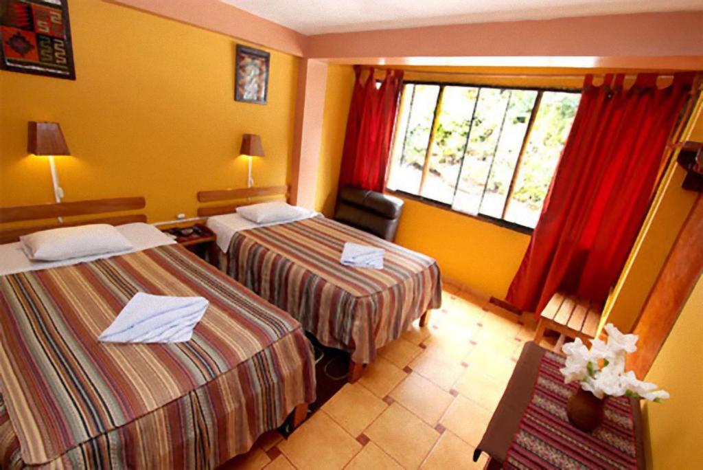 Un ou plusieurs lits dans un hébergement de l'établissement Hostal La Payacha
