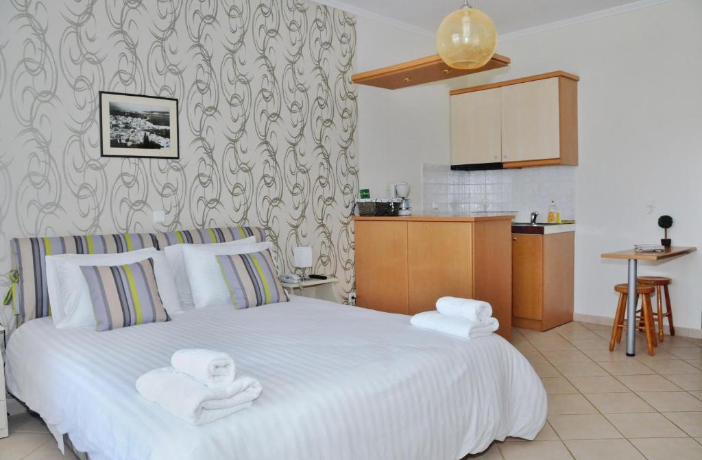 Ένα ή περισσότερα κρεβάτια σε δωμάτιο στο Το Κάστρο