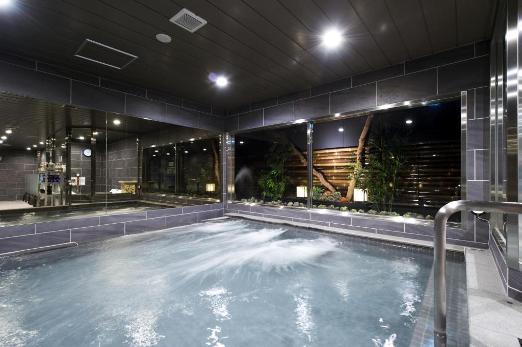 The swimming pool at or near Capsule Hotel Anshin Oyado Shinjuku