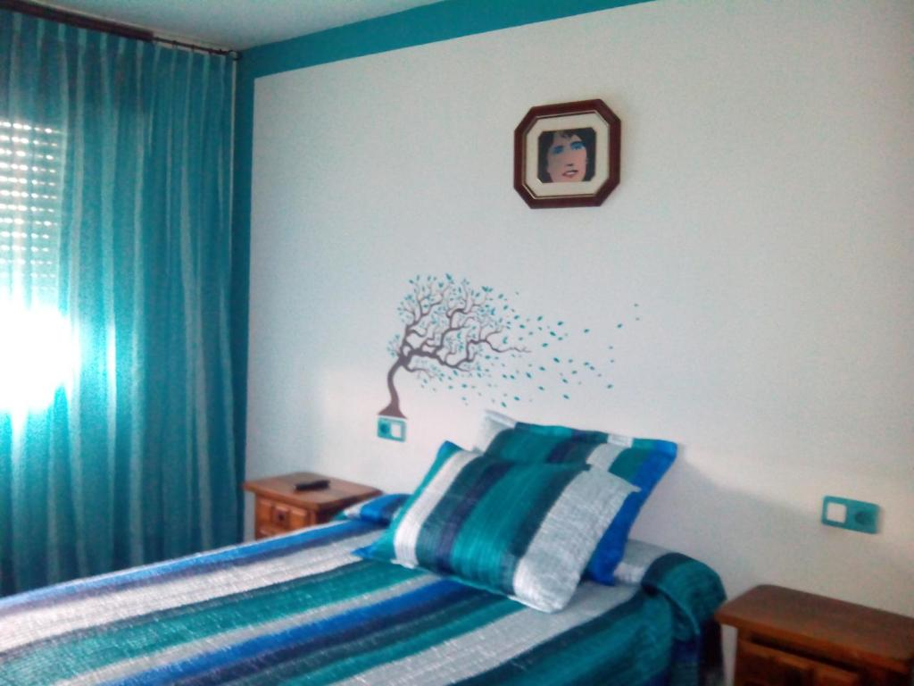 A bed or beds in a room at Albergue Pensión Flavia