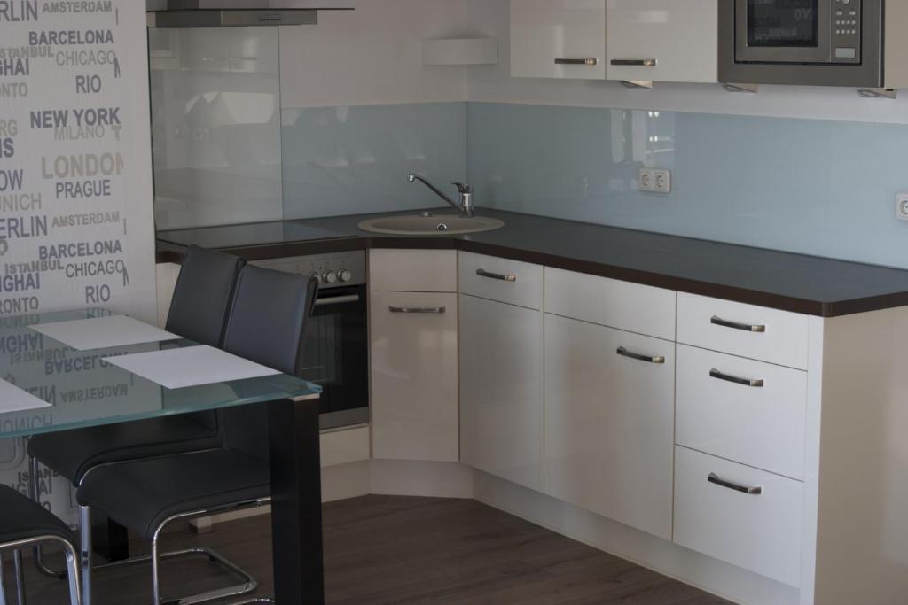 Küche/Küchenzeile in der Unterkunft Hommage Appartements