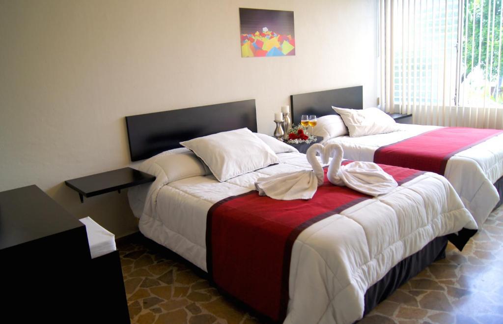 Cama o camas de una habitación en G y V Hotels