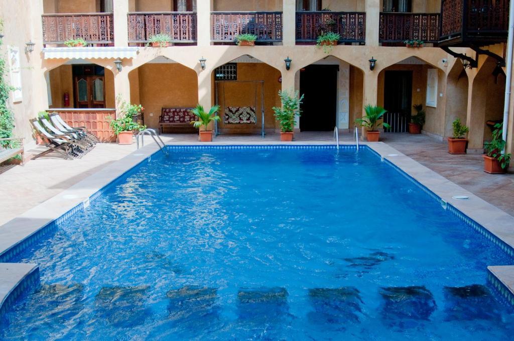 The swimming pool at or near Mizingani Seafront Hotel