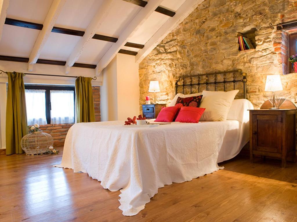 A bed or beds in a room at Posada Santa Ana