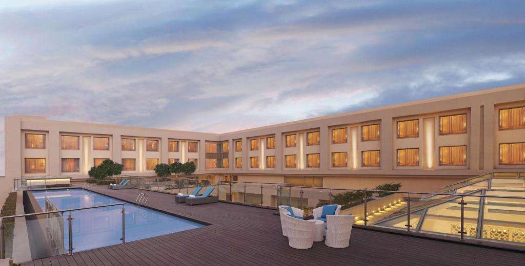 The swimming pool at or near DoubleTree by Hilton Agra