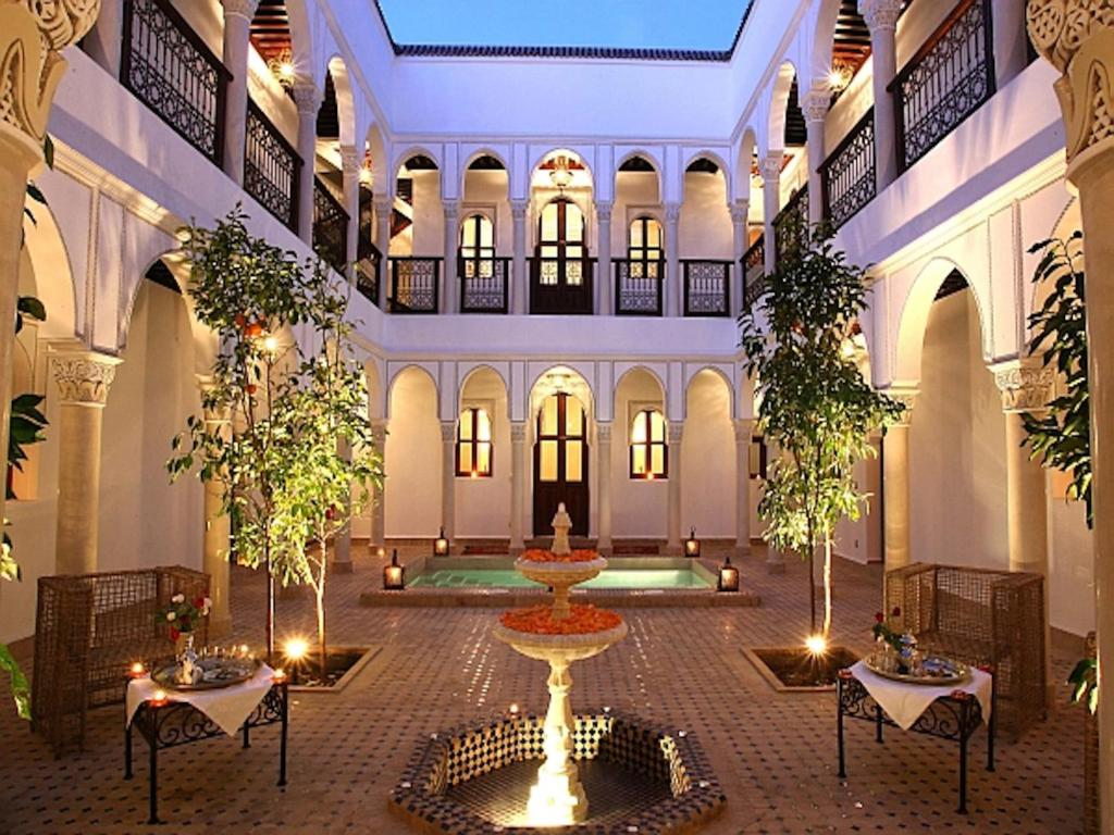 The swimming pool at or near Riad Le Jardin d'Abdou