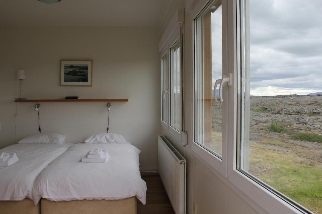 A bed or beds in a room at Hlid Bed and Breakfast