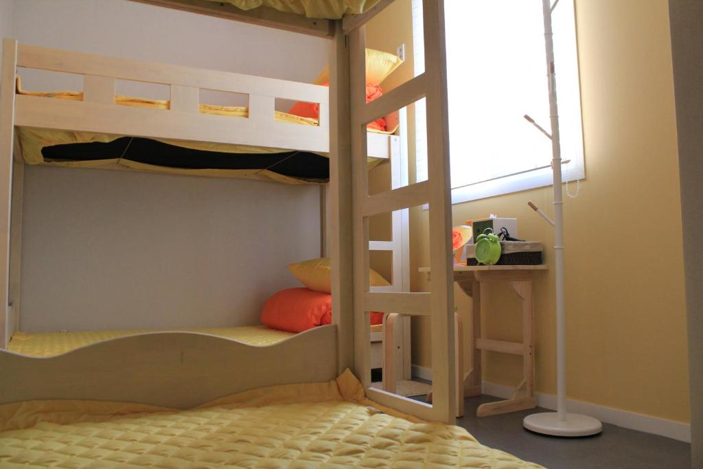 A bunk bed or bunk beds in a room at Egg House Namisum Guesthouse