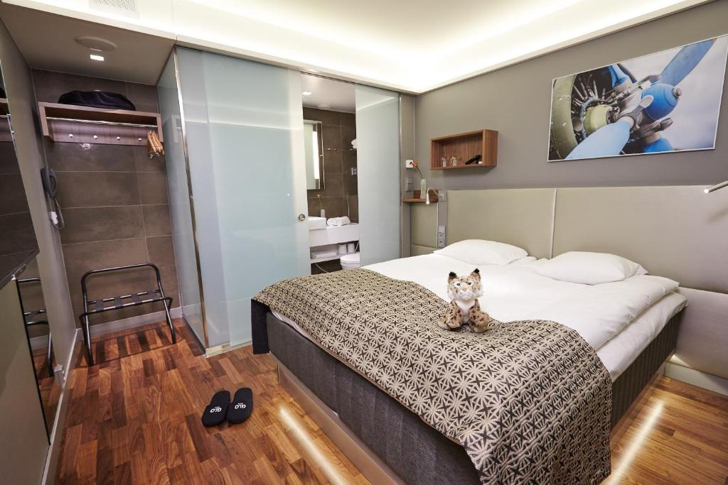 A bed or beds in a room at GLO Hotel Airport