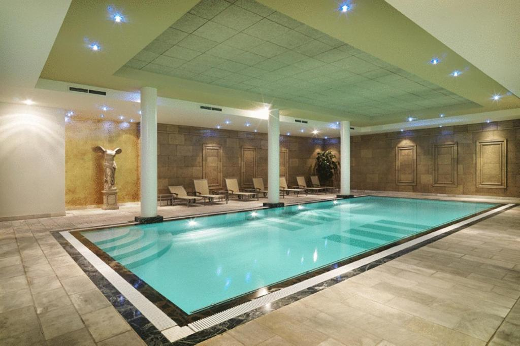 The swimming pool at or near Hyllit Hotel