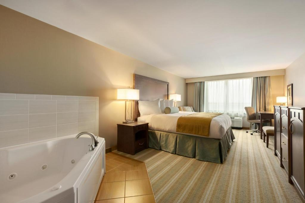 A king room with a whirlpool tub at the Country Inn & Suites by Radisson.
