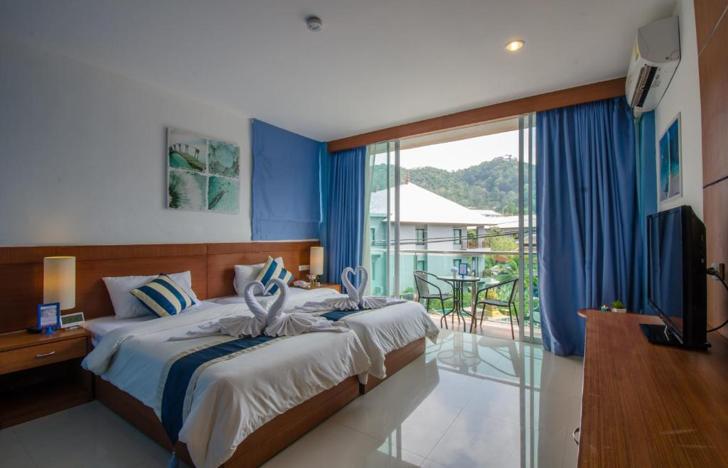 A bed or beds in a room at iCheck inn Ao Nang Krabi