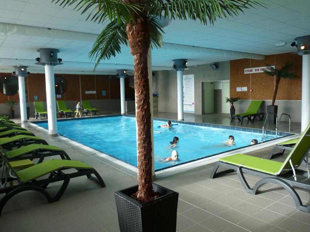 The swimming pool at or near VVF Villages « Les Sources de la Loire » Les Estables