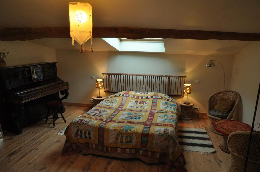 Un ou plusieurs lits dans un hébergement de l'établissement La Grange d'Agnès