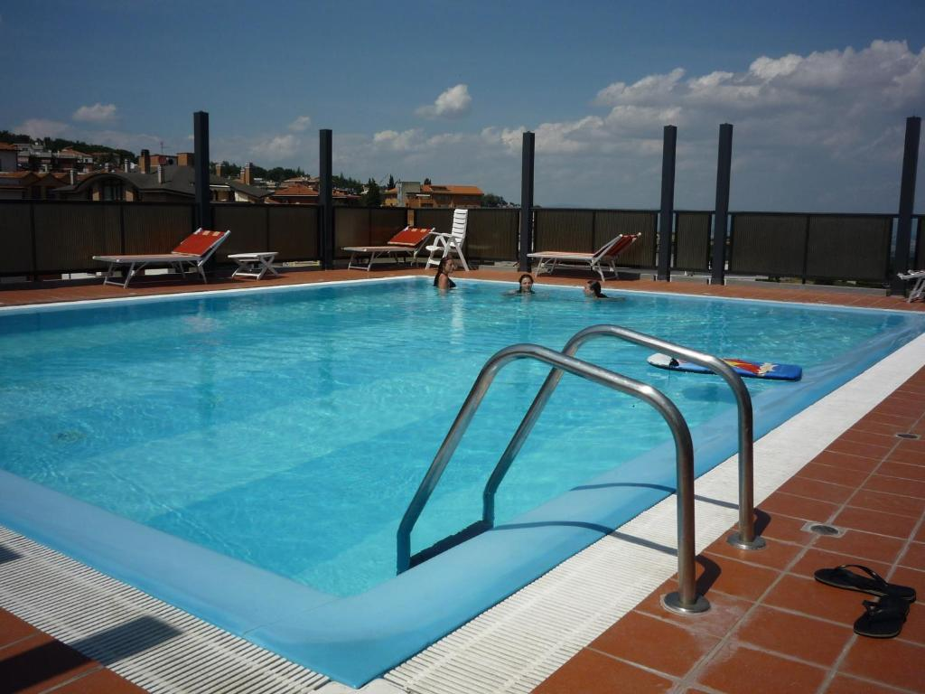 The swimming pool at or near Hotel Montecarlo