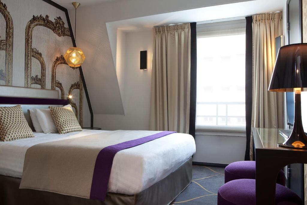 Un ou plusieurs lits dans un hébergement de l'établissement Hotel Yllen Eiffel