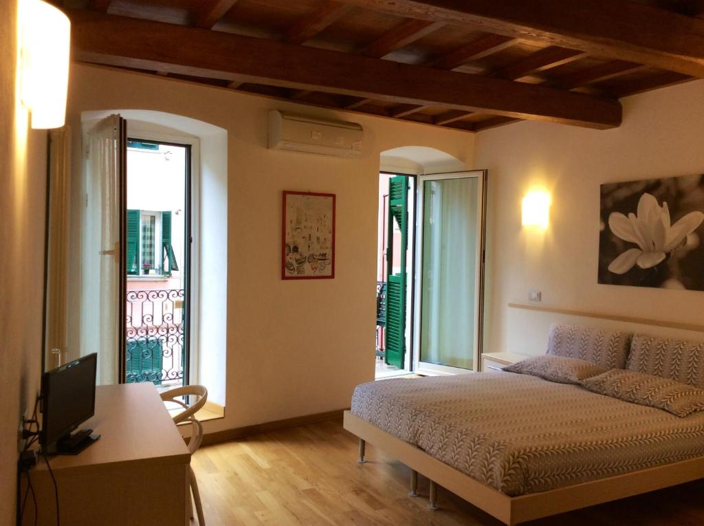 A bed or beds in a room at La Dolce Vita