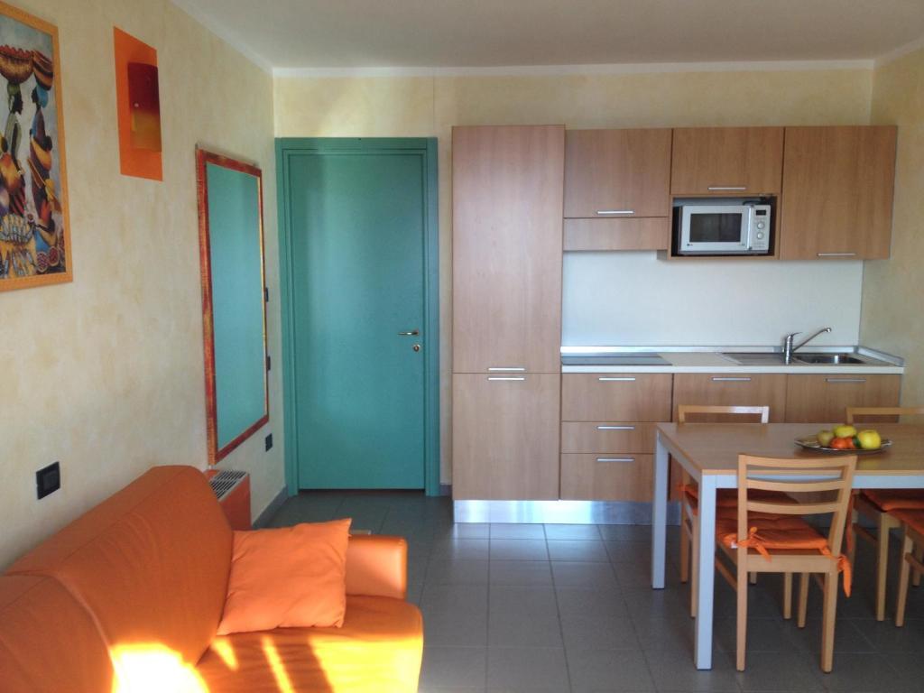 A kitchen or kitchenette at Appartamento Villaggio Olimpico
