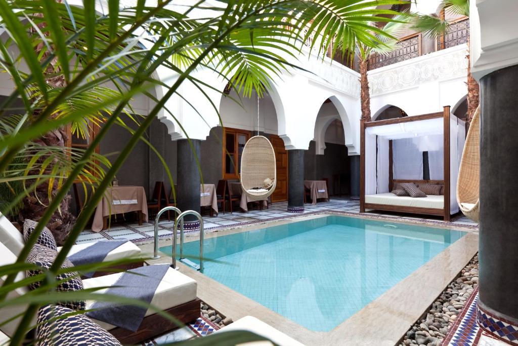 The swimming pool at or near Hotel & Spa Riad El Walaa
