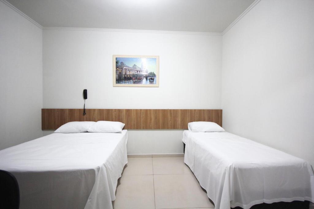 Cama ou camas em um quarto em Pousada Esmeralda Olímpia